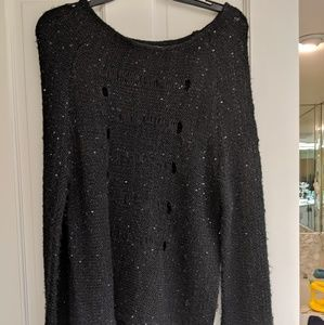 Black sweater with sequins and see through holes